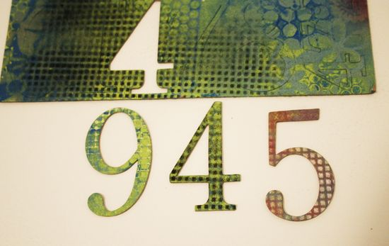 Chipboard numbers stenciled
