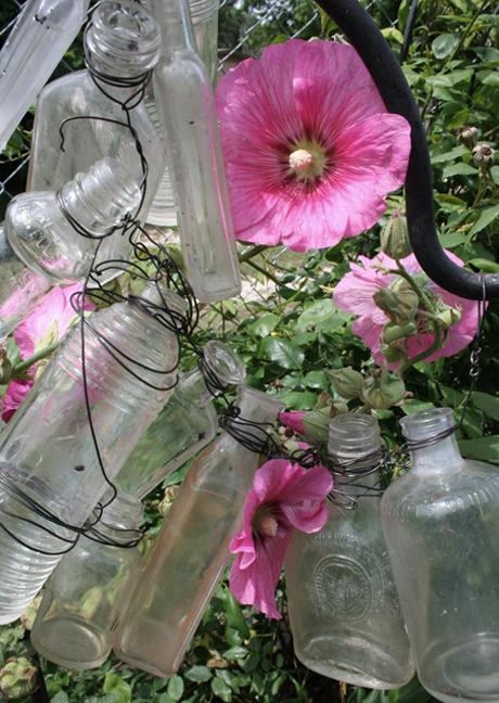 Bottle garden and hollyhocks
