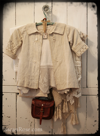 Creamy white linen and tooled leather
