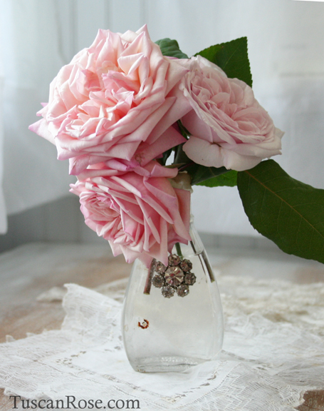 Roses in a found bottle with rhinestones