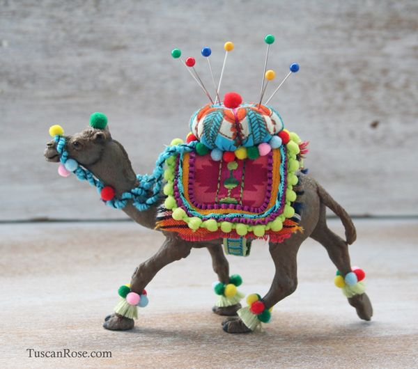 Decorated camel pincushion